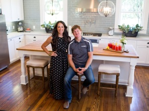 Hosts Chip and Joanna Gaines pose in the newly remodeled kitchen of the Dansby home, as seen on Fixer Upper. (portrait)